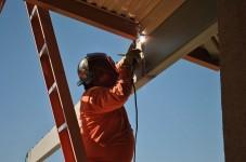Welder on Ladder