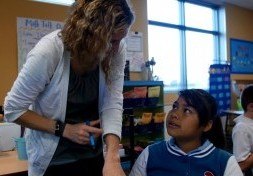 This image of a teacher and student will link to the Academic Services Department page.