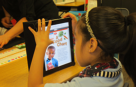 This image of a student using an iPad will link to the Technology department page.