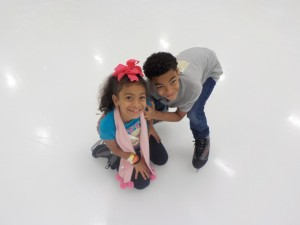 Siblings ice skating